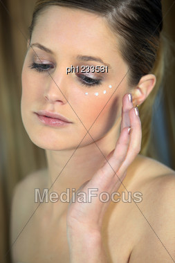 Woman Applying Cream On Your Face Stock Photo