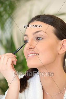 Woman Applying Eyeliner Stock Photo
