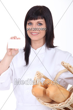 Woman Baker Showing Business Card Stock Photo