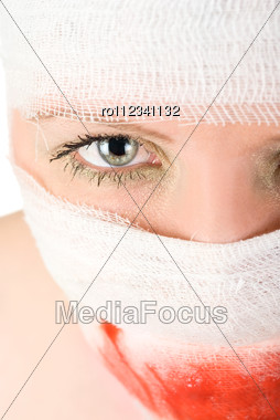 Woman With Bandages With Blood On Her Face Stock Photo