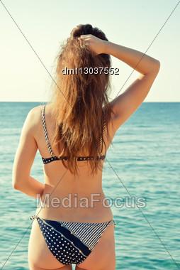 Woman In Bikini Rotated Back Looking At Sea Panorama View Stock Photo