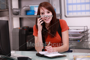 Woman Booking Customer Appointment Stock Photo