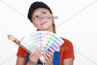Woman Choosing Color On Swatches Stock Photo