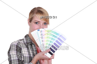 Woman Choosing New Color For House Stock Photo