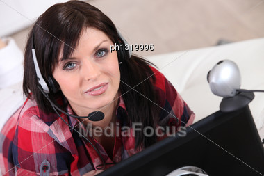 Woman Communicating Through A Webcam Stock Photo