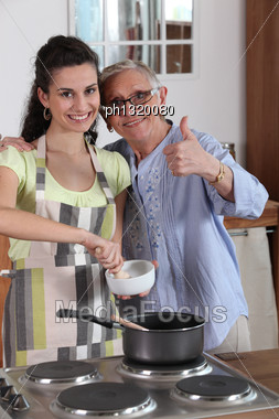 Woman Cooking With Her Grandmother Stock Photo