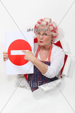 Woman With Curlers And No Trespassing Sign Stock Photo