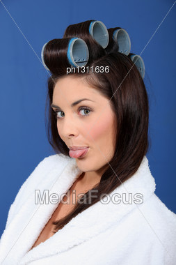 Woman With Curlers Sticking Out His Tongue Stock Photo