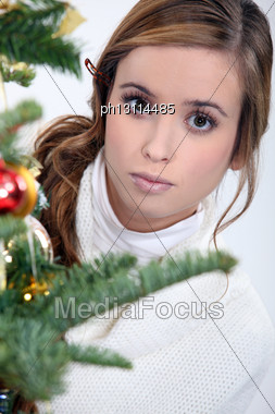 Woman Decorating A Christmas Tree Stock Photo