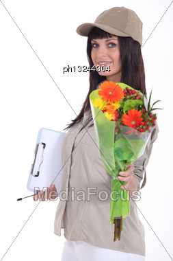 Woman Delivering Bouquet Of Flowers Stock Photo