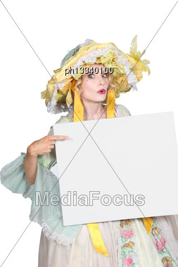 Woman In Disguise Pointing To Blank Message Board Stock Photo