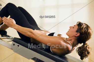 Woman Doing Abdominal Exercises Stock Photo