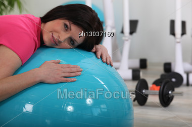 Woman Doing Exercises With A Ball Stock Photo
