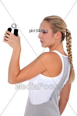 Woman Doing Wrist Exercises Stock Photo