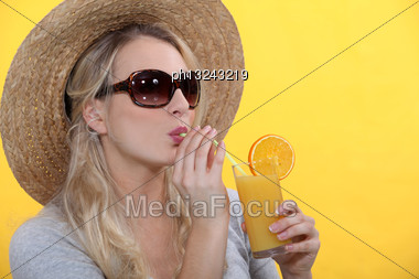 Woman Drinking Orange Juice Stock Photo