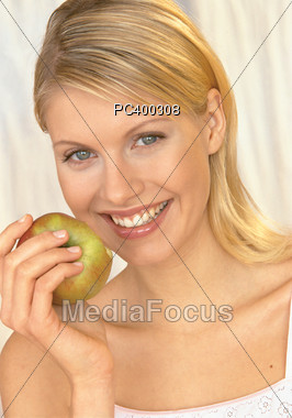 Woman Eating and Looking Healthy Stock Photo