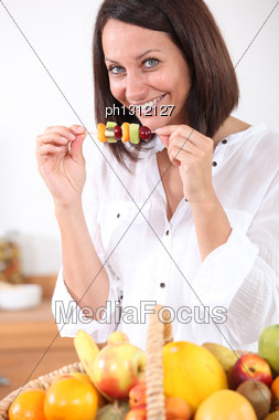 Woman Eating Fruit Stock Photo