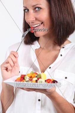 Woman Eating Fruit Salad Stock Photo