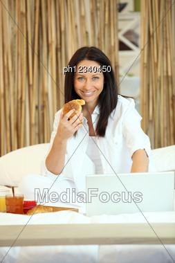 Woman Enjoying Breakfast In Bed Stock Photo