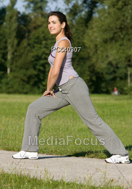 Woman Exercising Outdoors Stock Photo