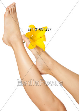 Woman's Feet And Legs With Flower Isolated On White. Manicure And Pedicure Concept. Nails. Spa Stock Photo
