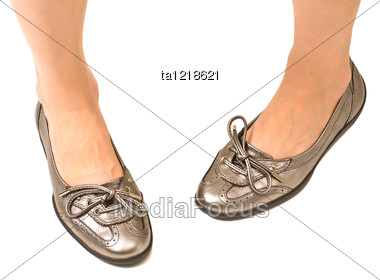 Woman In Flat Shoes Stock Photo