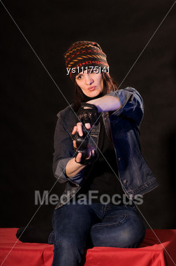 Woman Gamer With Joystick On Darken Background Stock Photo