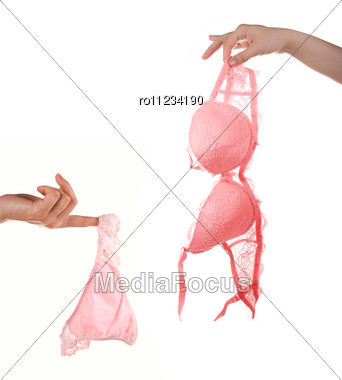 Woman Hands Hold Pink Bra And Pants Stock Photo