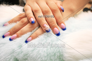 Woman Hands On Fur Background. Stock Photo
