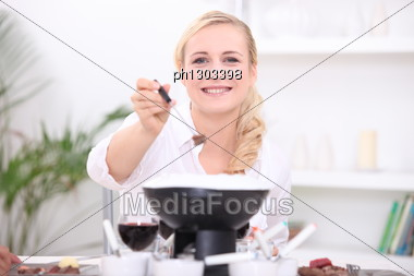Woman Having A Fondue Bourguignonne Stock Photo