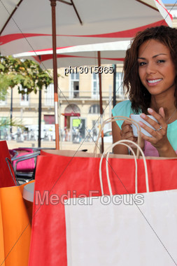 Woman Having Coffee After Shopping Stock Photo