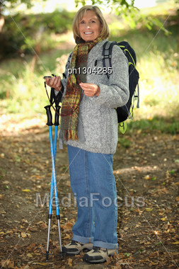Woman Hiking In Woods Stock Photo