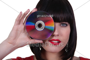 Woman Holding A Compact Disk Stock Photo
