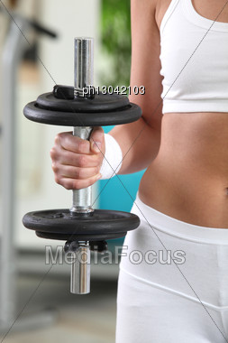 Woman Holding A Dumbbell Stock Photo
