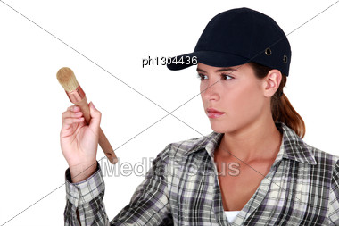 Woman Holding A Paintbrush Stock Photo