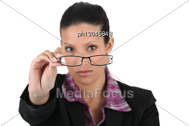 Woman Holding A Pair Of Glasses Stock Photo