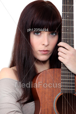 Woman Holding Acoustic Guitar Stock Photo