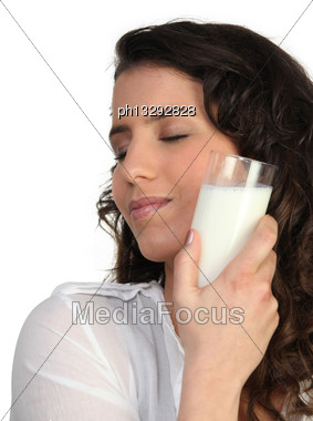 Woman Holding Glass Of Milk Stock Photo