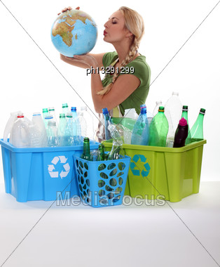 Woman Holding Globe Recycling Bottles Stock Photo