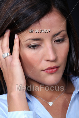 Woman Holding Her Head Stock Photo