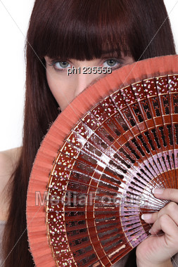 Woman Holding Oriental Hand-fan Stock Photo