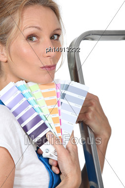 Woman Holding Paint Swatches Stock Photo