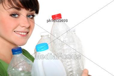 Woman Holding Plastic Bottles Stock Photo