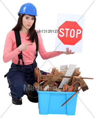 Woman Holding Stop Sign Stock Photo