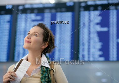 Woman Holding Tickets In Your Hand And Looks Up Stock Photo