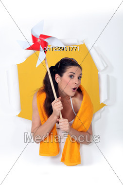 Woman Holding Toy Windmill Stock Photo
