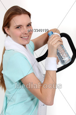 Woman Hydrating Herself After Workout Stock Photo