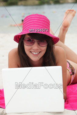 Woman In A Pink Hat Stock Photo