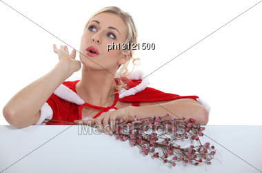 Woman In A Santa Claus Suit Stock Photo