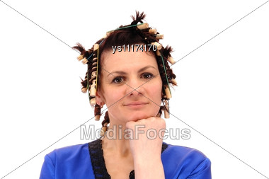 Woman In Curlers Stock Photo